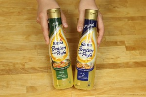 Olive (grünes Etikett links) und Original (blaues Etikett rechts)
